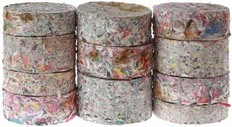 Stack of Compressed Paper Log Briquettes Cutout/Biomass Briquettes